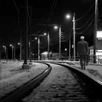 man walking railway track